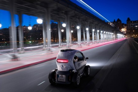 Renault Twizy Electric Car - Rear view, driving through streets