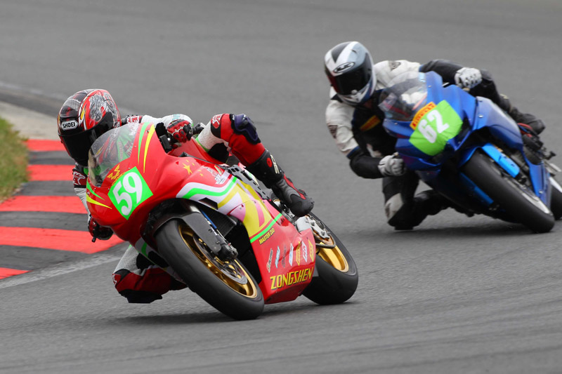 Number 59 Rider Ho Chi Fung on the Zongshen AC, Winner at Oschersleben 17th August 2013