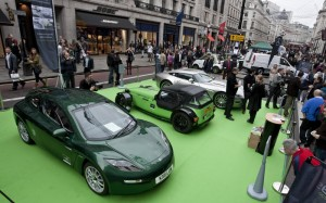 Regent Street Motor Show, a Delta Electric Car in the foreground sits quietly beside a Caterham and Aston Martin