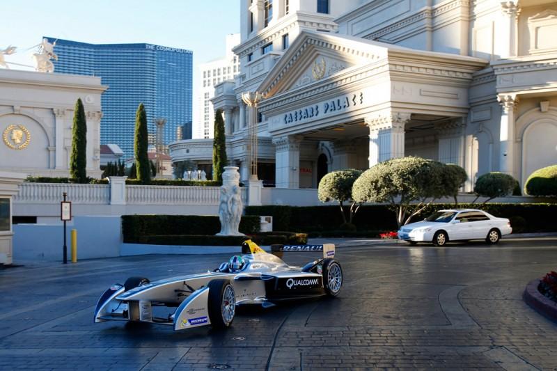Lucas di Grassi driving the Formula E car outside Caesars Palace in Las Vegas