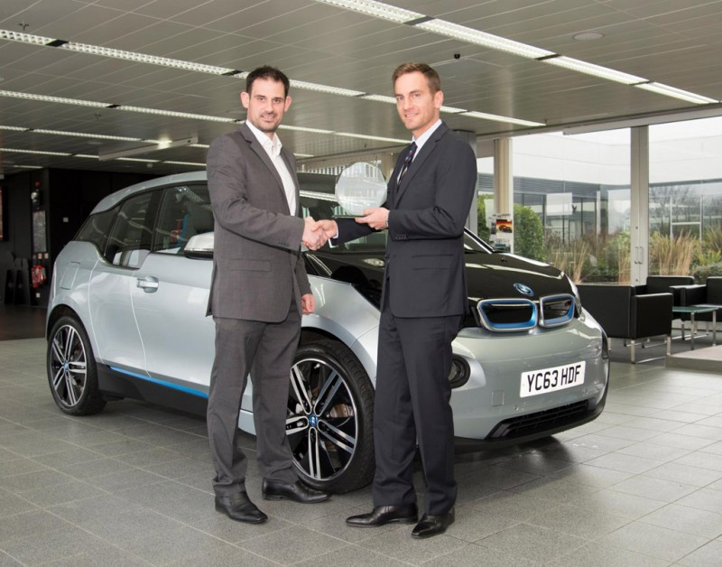 Uwe Dreher, BMW UK's Marketing Director, receives the UK Car of the Year 2014 trophy from John Challen, Managing Director of UK Car of the Year, and Editor of ukcoty.co.uk.