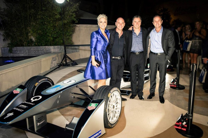 [From left to right]: Catherine Banchard, CEO of ONE DROP, Guy Laliberté, Founder of Cirque du Soleil, and Formula E representatives Chris Schroeder and Robert Lavia beside the Formula E car during the announcement of the new Formula E and ONE DROP partnership.