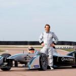 3. Italian Jarno Trulli beside the Formula E car