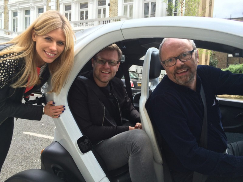 Formula E commentary team Nicki Shields (left) Jack Nicholls (centre) and Robert Llewellyn beside a fully-electric Renault Twizzy.