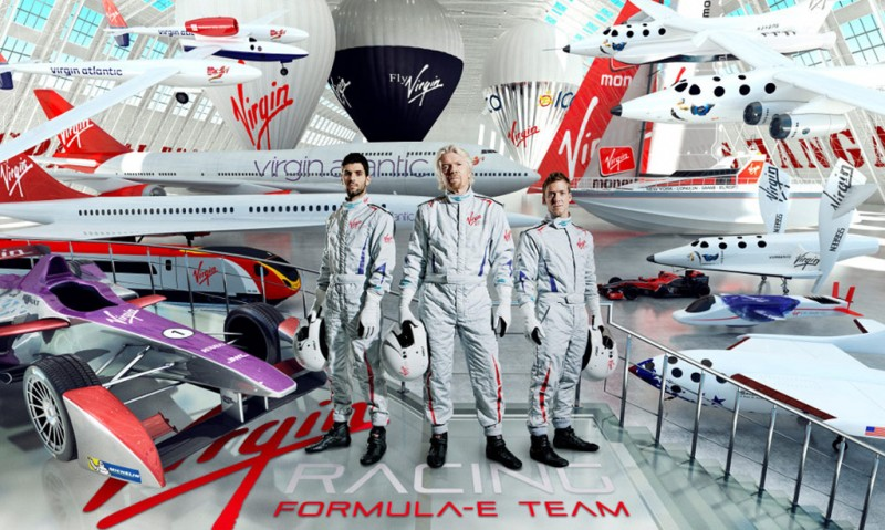 Sir Richard Branson (centre) reveals the driver line up for the Virgin Racing Formula E team with Jaime Alguersuari (left) and Sam Bird (right)
