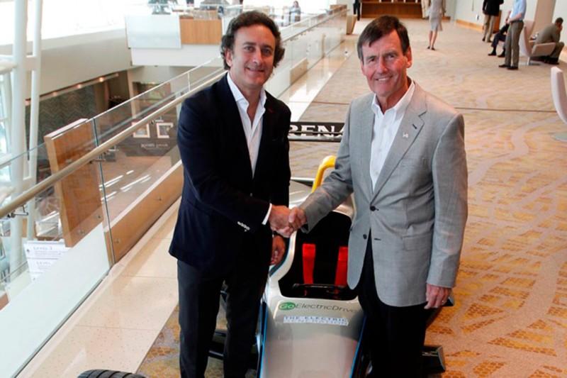 Formula E CEO Alejandro Agag (left) with EEI President Tom Kuhn beside the fully electric Formula E race car
