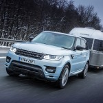 Range Rover Sport Hybrid towing Airstream in the snow