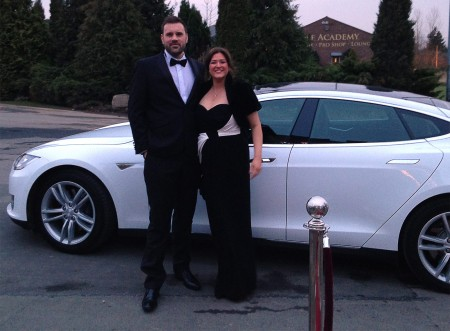 ELM EVs Daniel Martin and Suzie Guest with the Tesla S