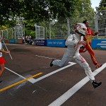 Drivers race to the finish line in the 100m sprint - Formula E Visa London ePrix Battersea Park